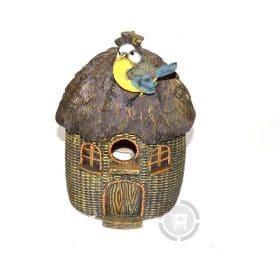 Vogelhuisje met vogel