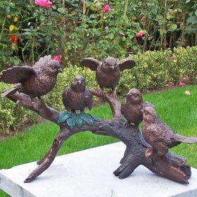 bronzen vogeltjes op tak