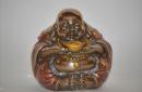 Boeddha dikbuik met goudschaal